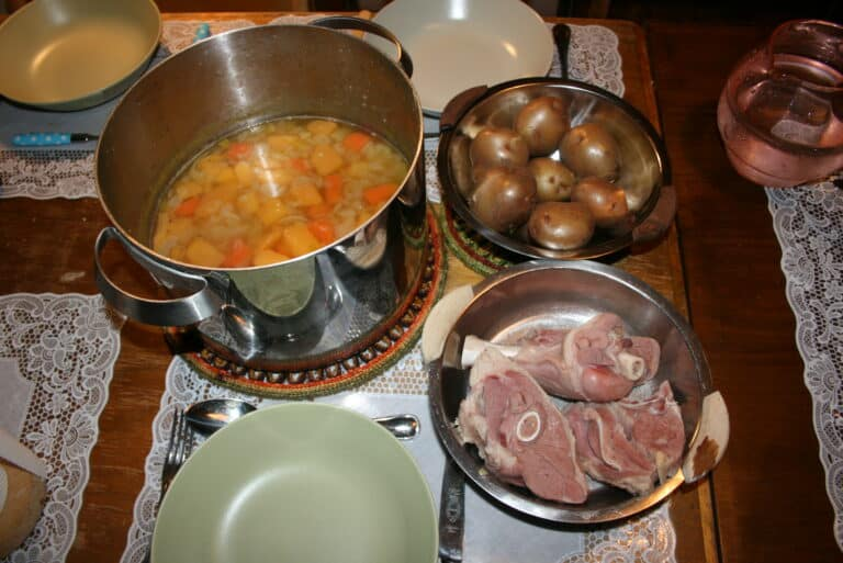 sprengidagur or explosion day in Iceland. A kitchen table is laden with lots of local food and icelandic delicacies